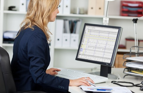 graphic: woman working at computer