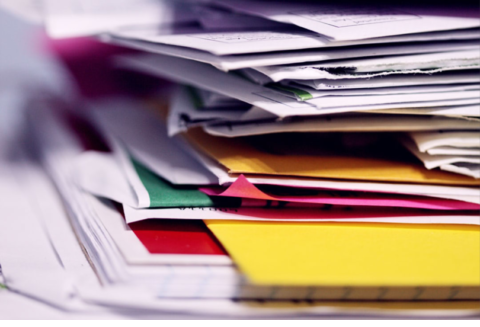graphic: stack of papers and folders